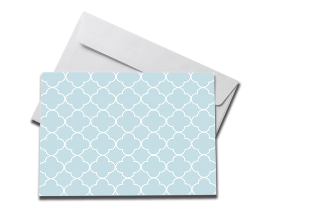 Light Blue Patterned Sympathy note laying on a white envelope