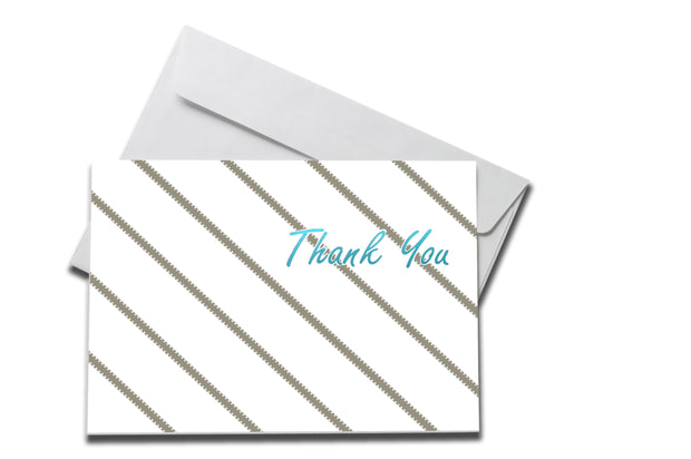 Foiled Grey Striped Thank You Card laying on a white envelope