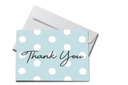Blue Polka Dot Thank You Card Laying on White Envelope