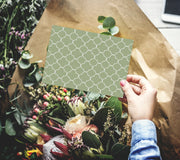 Dusty Green Sympathy or Get Well Soon Card in someone's hand overlooking flowers