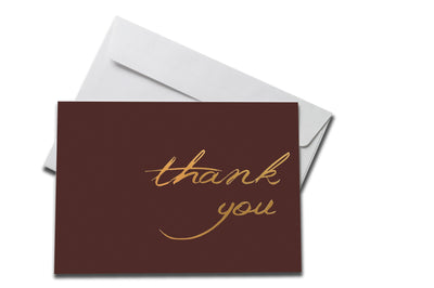 Foiled Maroon Thank You Card laying on a white envelope