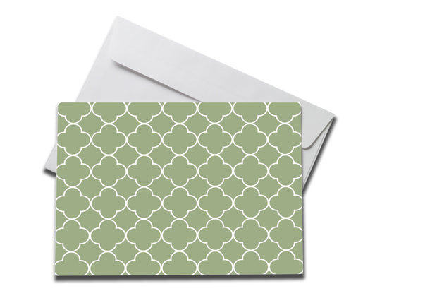 Green Patterned Sympathy Card laying on a white envelope
