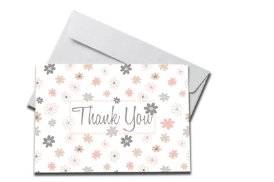 Pastel Floral Thank You Card laying on a white envelope