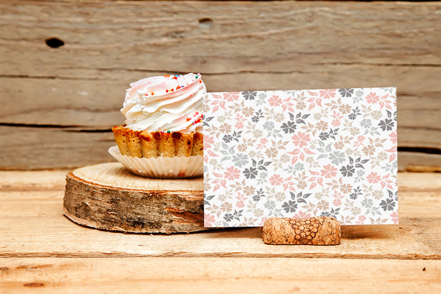 Pastel Floral Sympathy note next to a cupcake on a wood table