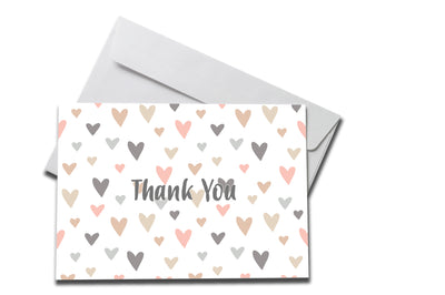 Pastel Hearts Thank You Card laying on a white envelope