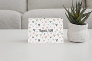 Pastel Hearts Thank You Card open and standing next to a small green cactus plant
