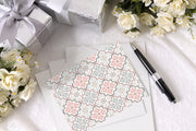 Pastel Pattern Get Well Soon Card and envelope laying next to presents