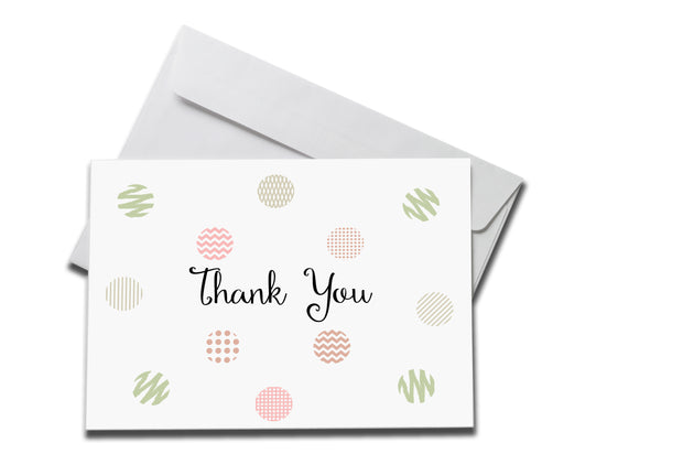 Polka Dot Thank You Card laying on a white envelope