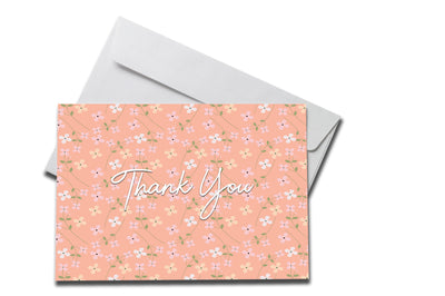Peach Floral Thank You Card laying on a white envelope