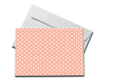 Peach Polka Dot Sympathy note laying on a white envelope