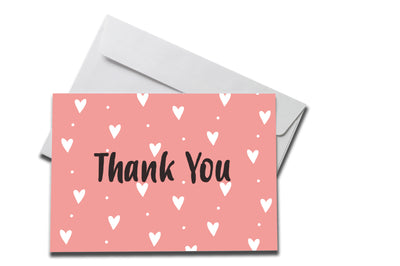 Pink Hearts Thank You Card laying on a white envelope