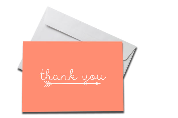 Salmon with Arrow Thank You Card laying on a white envelope