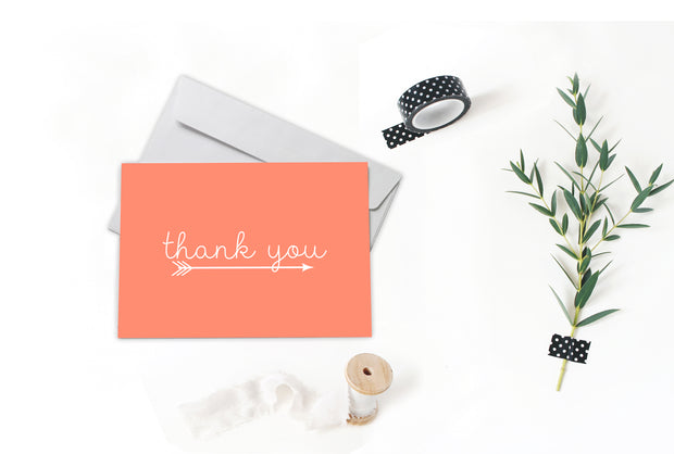 Salmon Arrow Thank You Note surrounded by spool, greenery and tape