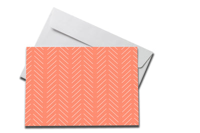 Salmon Slanted Lines Sympathy note laying on a white envelope