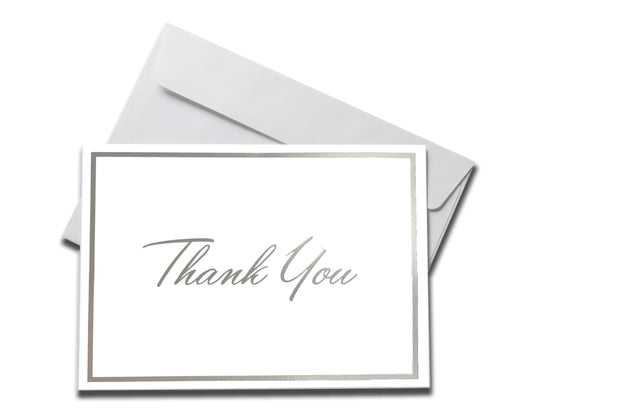 Foiled Silver Thank You Card laying on a white envelope