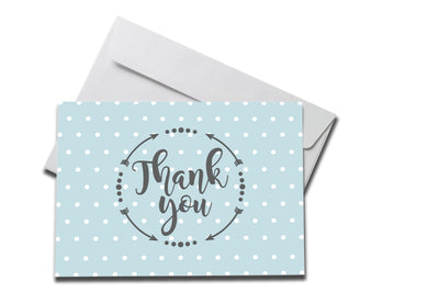 Small Blue Polka Dot Thank You Card laying on a white envelope