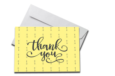 Yellow Arrows Thank You Card laying on a white envelope