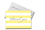 Yellow Striped Thank You Card laying on a white envelope