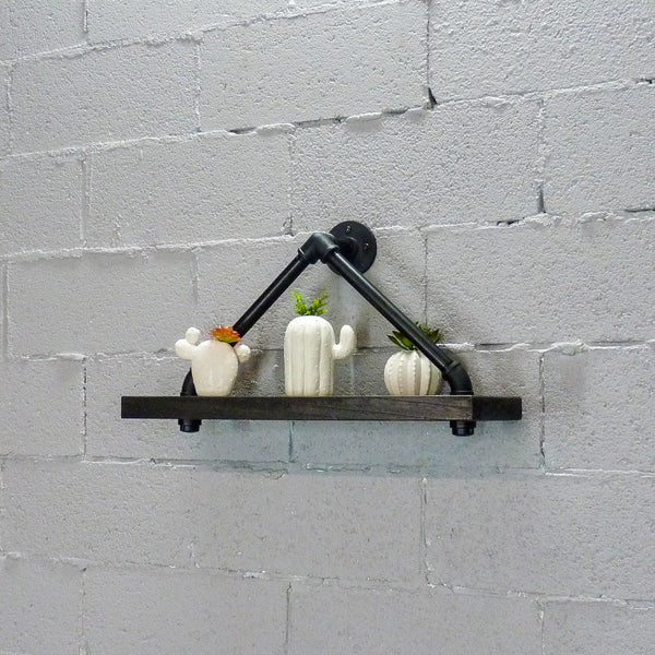 Rustic triangle wall shelf made of Paulownia wood and aluminum pipes with house plants.