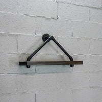 Rustic industrial triangle wall shelf made of Paulownia wood and aluminum pipes.