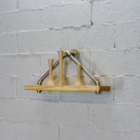 Rustic triangle wall shelf made of Paulownia wood and aluminum pipes.