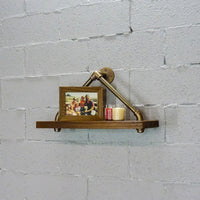 Rustic triangle Paulownia wood wall shelf with aluminum pipes, decorative candles and framed picture.