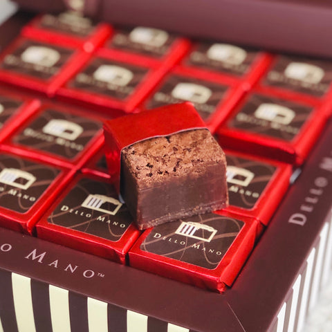 Red foiled brownies in a chocolate gift box