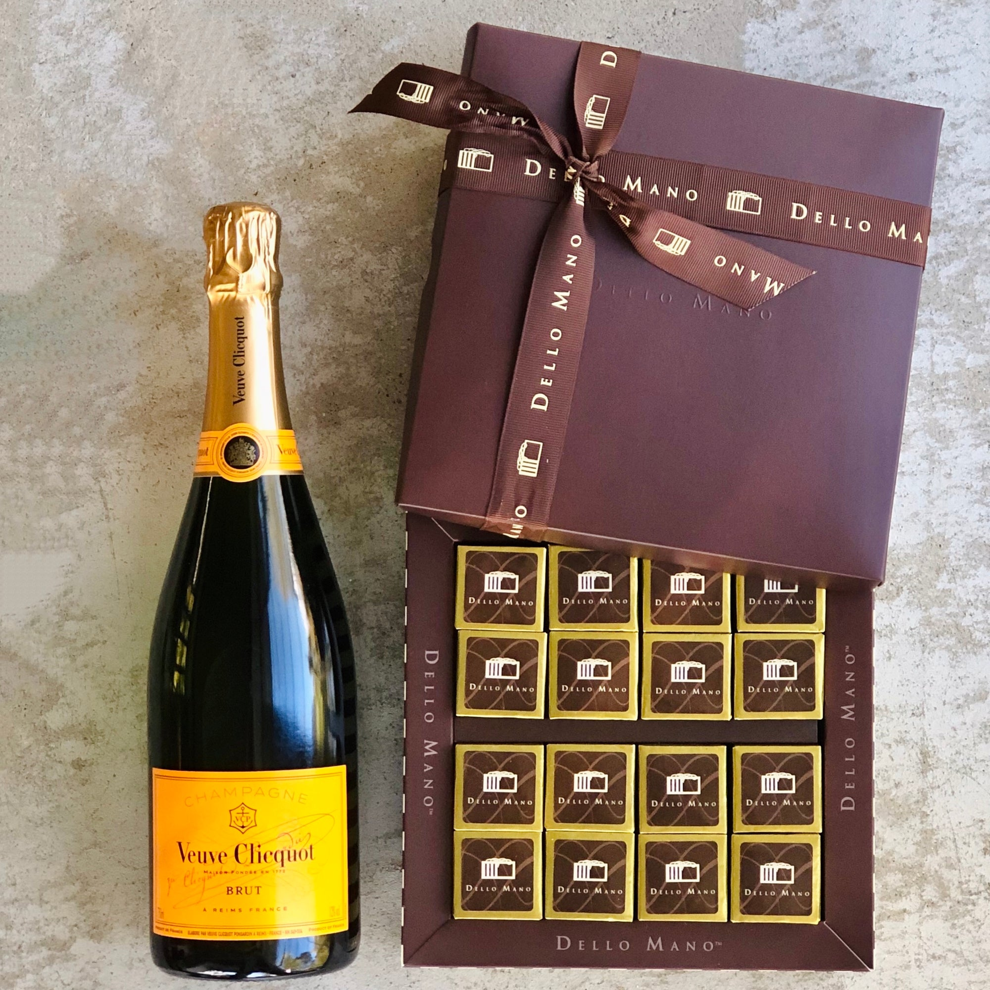 A bubbles and brownie hamper with one bottle of veuve clicquot champagne and box of brownies