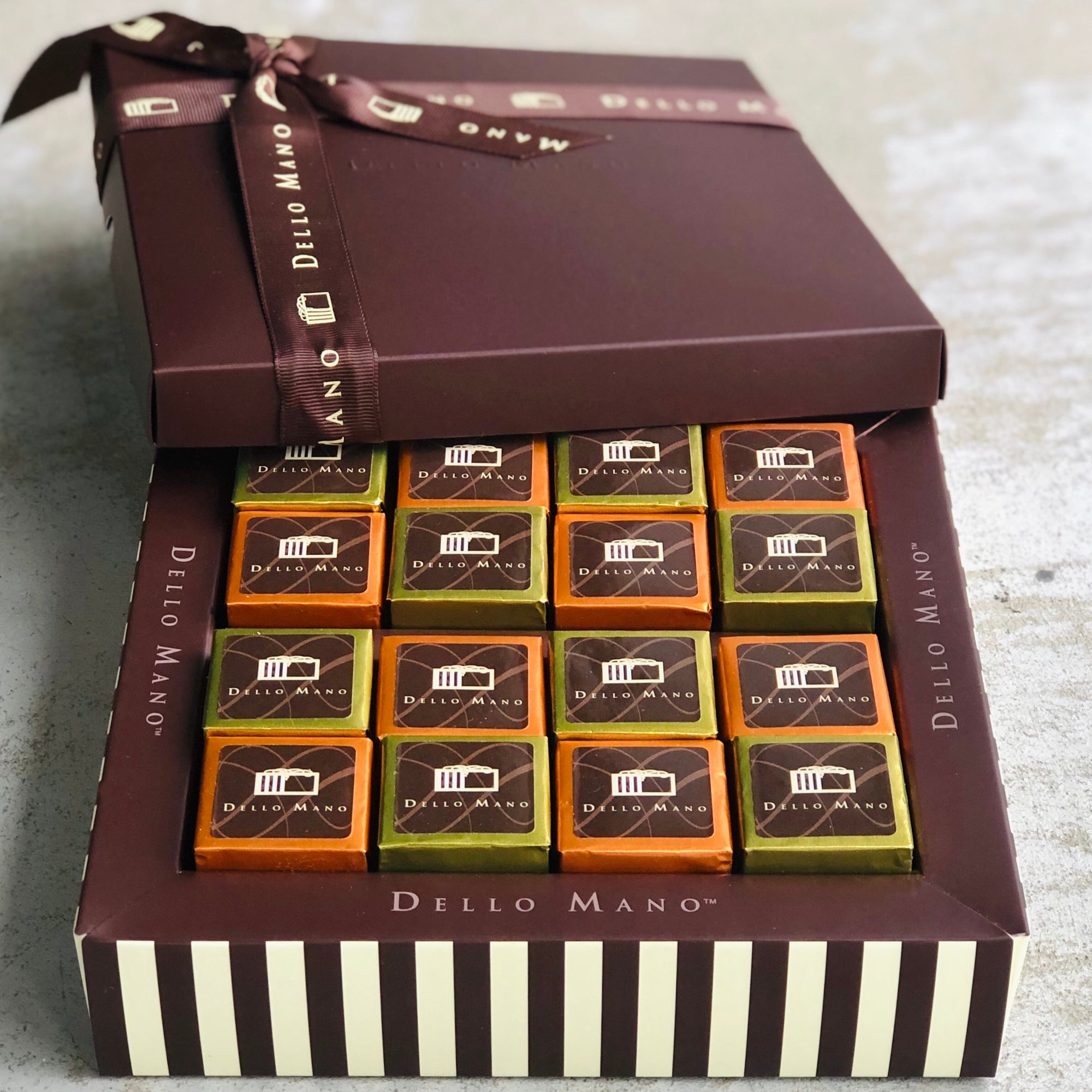 An open individually wrapped gourmet salted caramel  brownie on a chocolate gift box