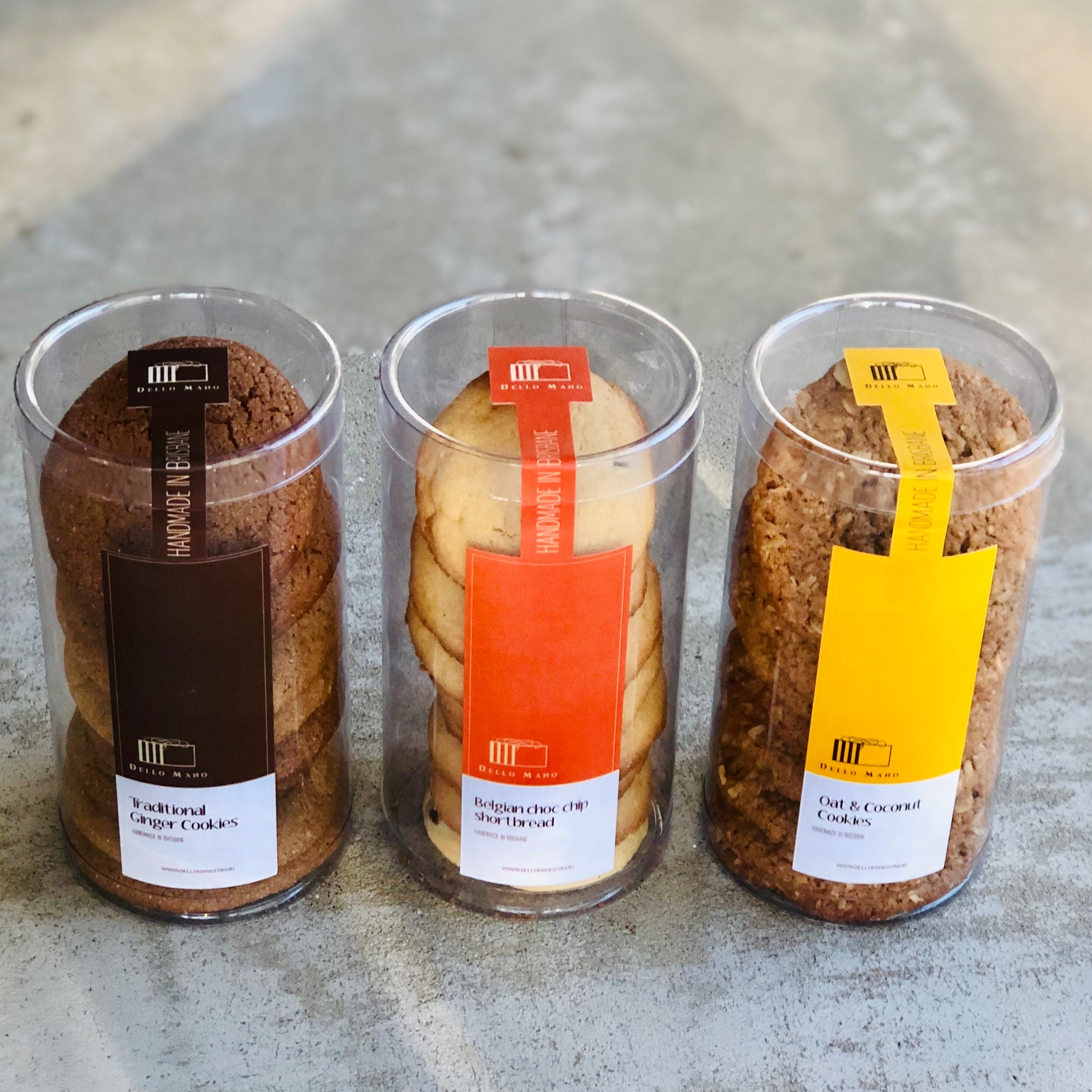 Three tubes of cookies each with different coloured labels
