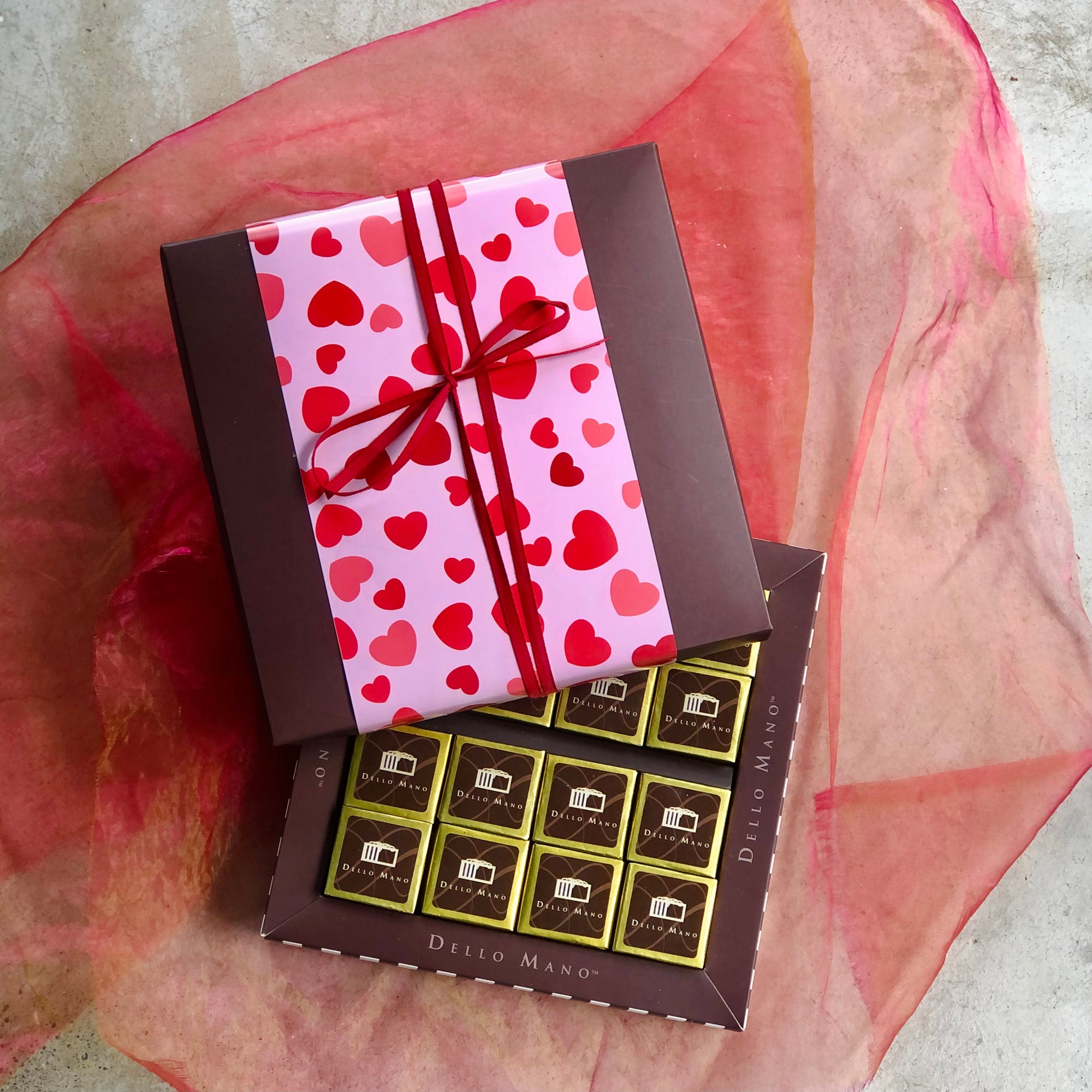 Dello Mano logo brownies in a Valentine Chocolate Gift Box and red ribbon tie