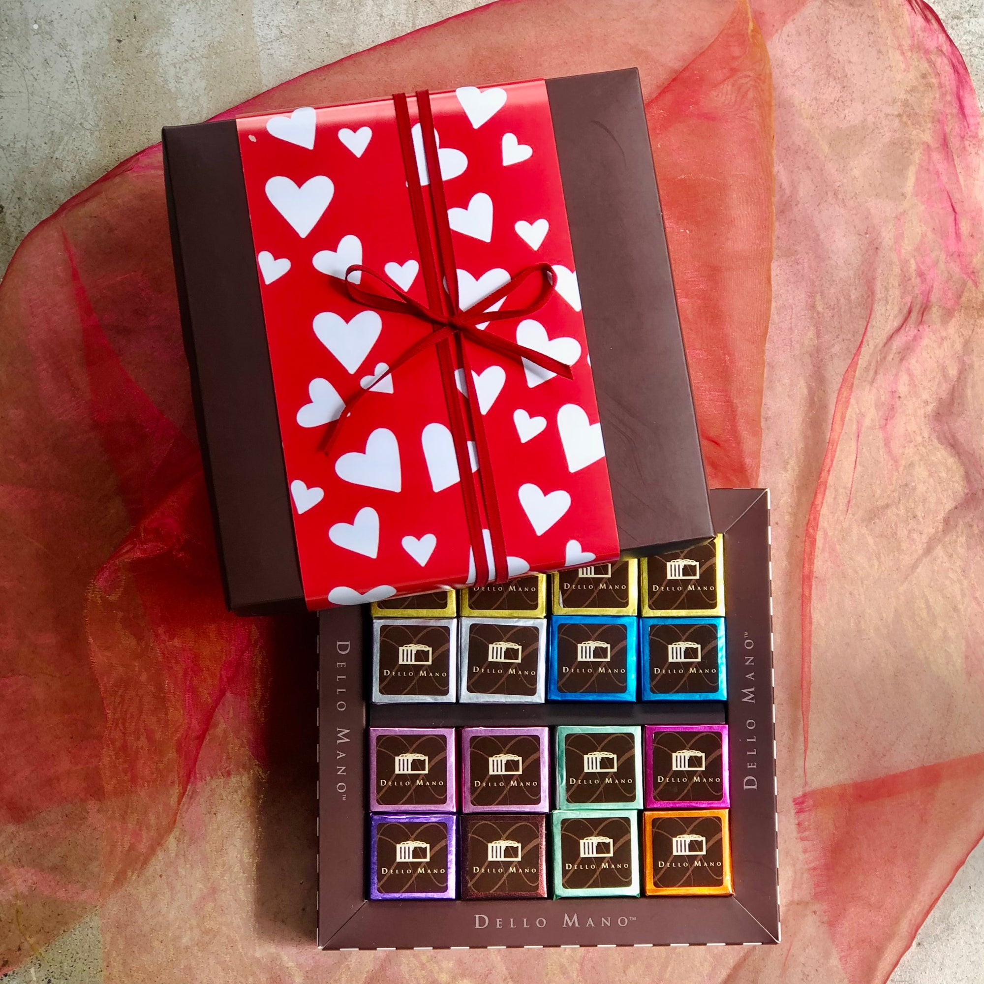 An open Valentine Chocolate gift box of mixed brownies