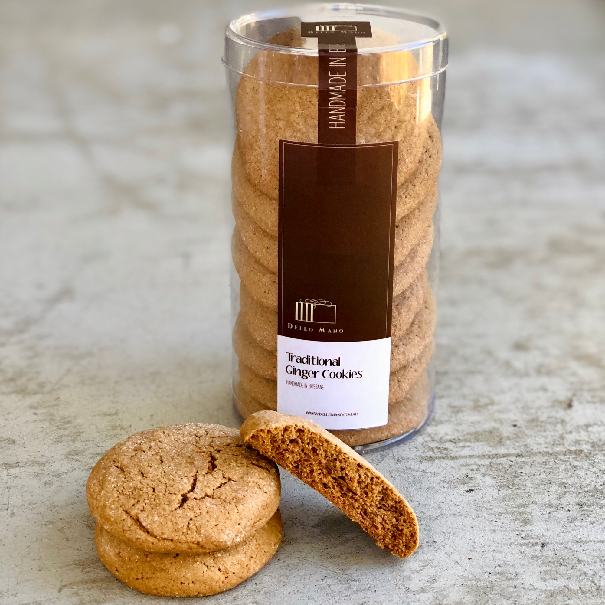 Traditional Ginger Cookies split open in front of a tube of cookies with brown label