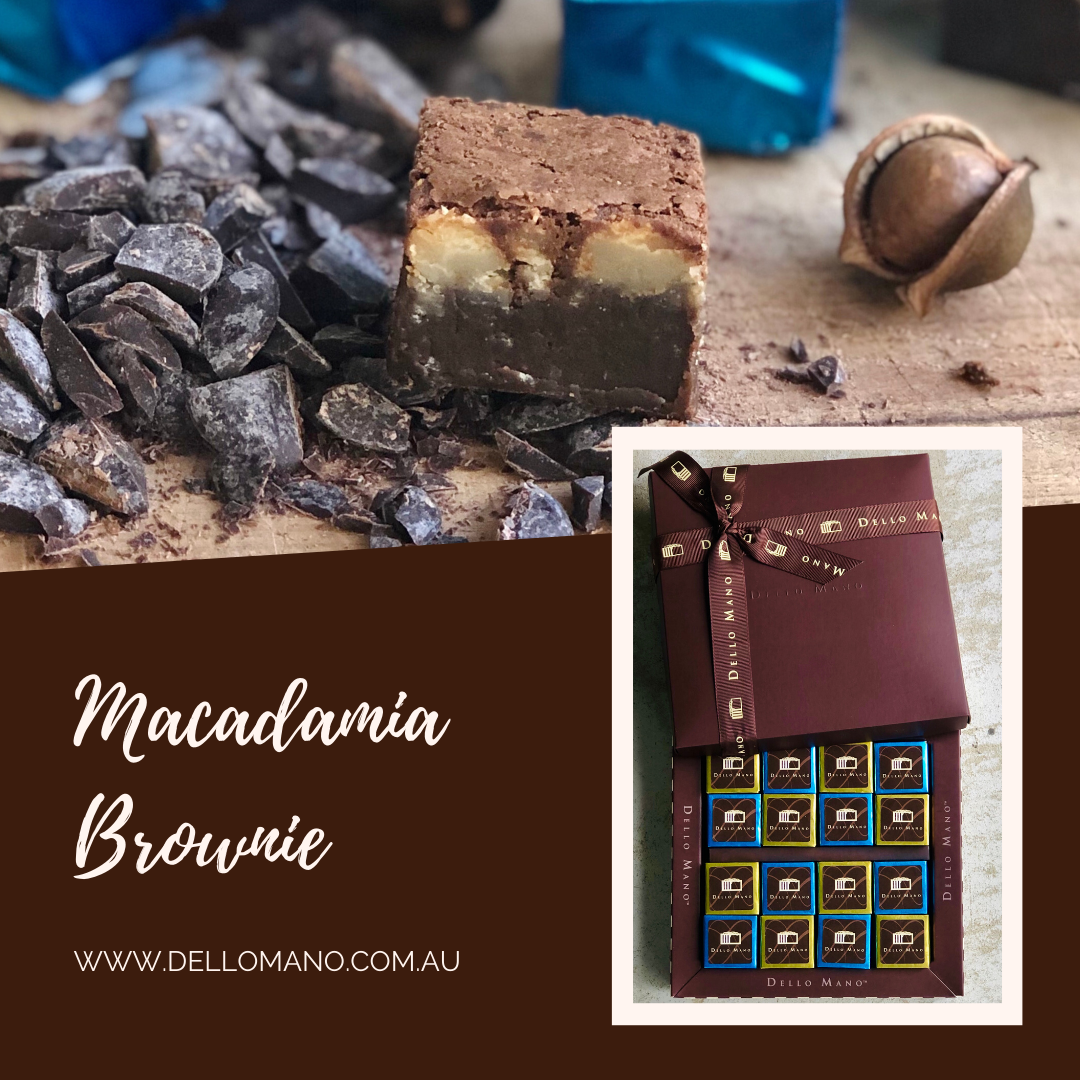 A honey caramalised macadamia brownie exposed by open foil wrapping on top of a brownie gift box