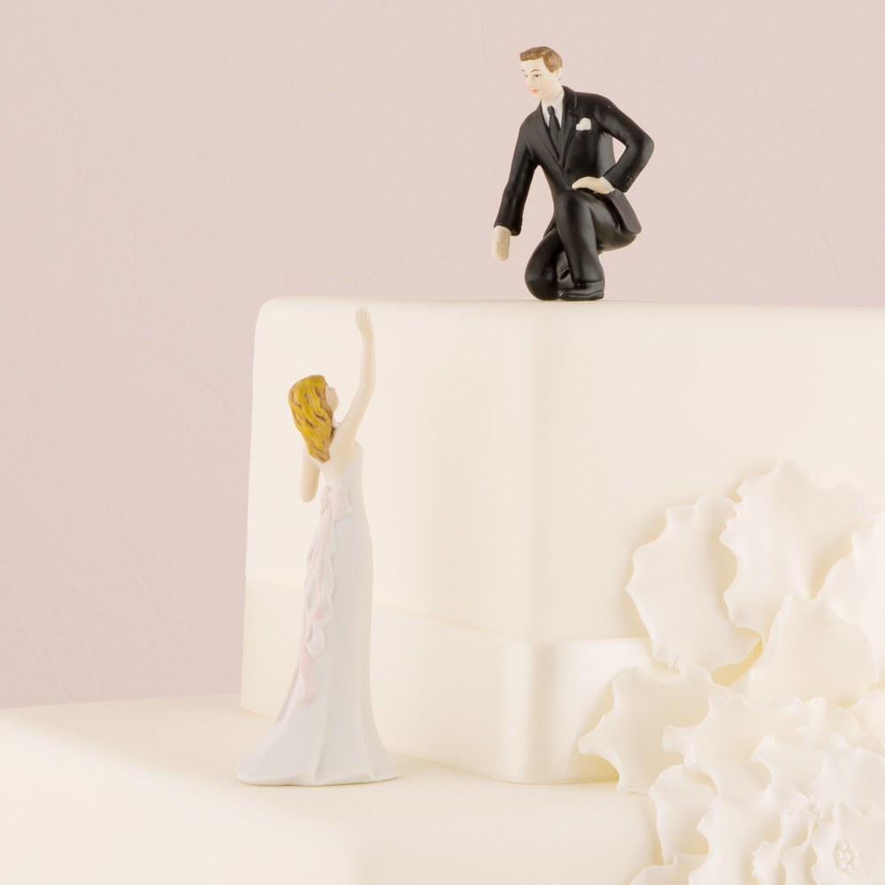 Reaching Bride and Helpful Groom Wedding Cake Topper