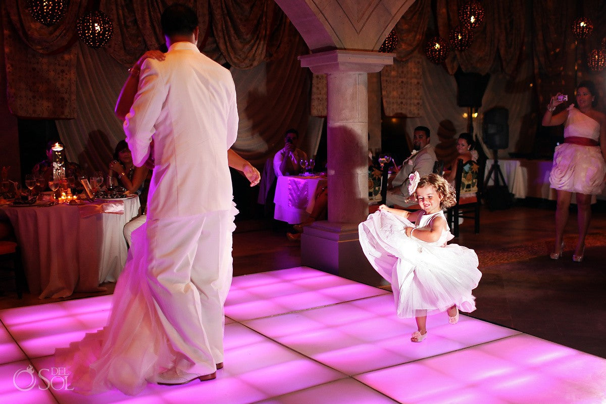 flowergirl dancing on the dance floor in wedding reception at xcaret