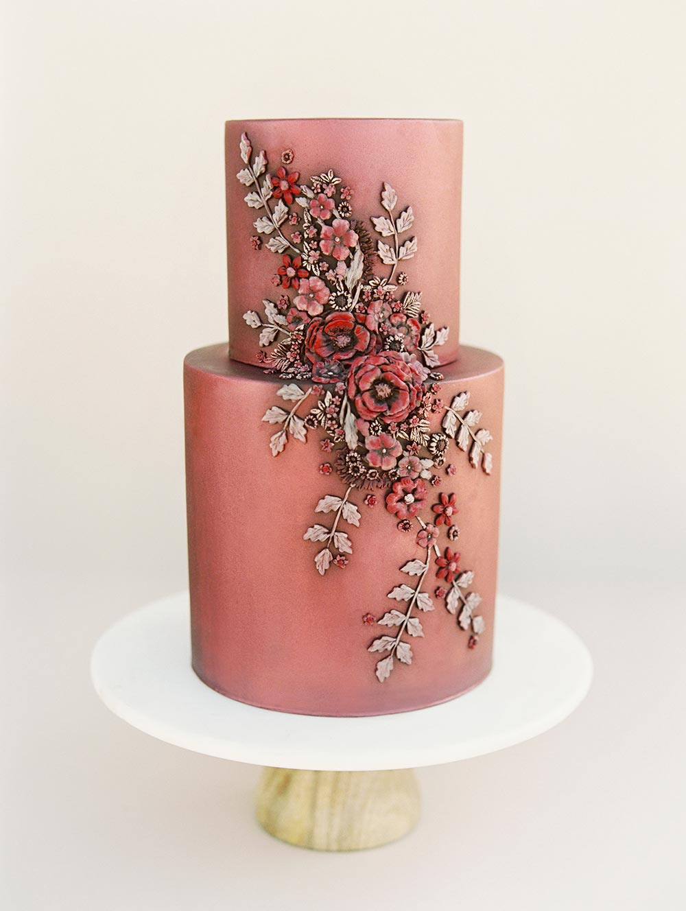 metallic burgundy wedding cake with sugar flowers