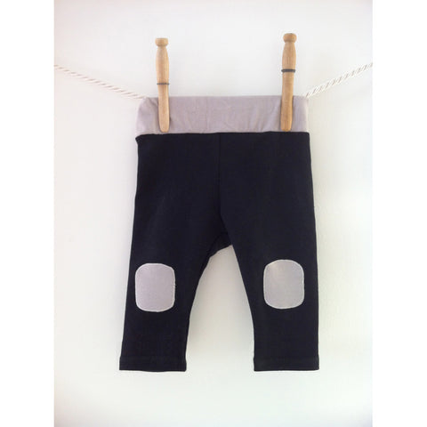Black and grey knee patch pants