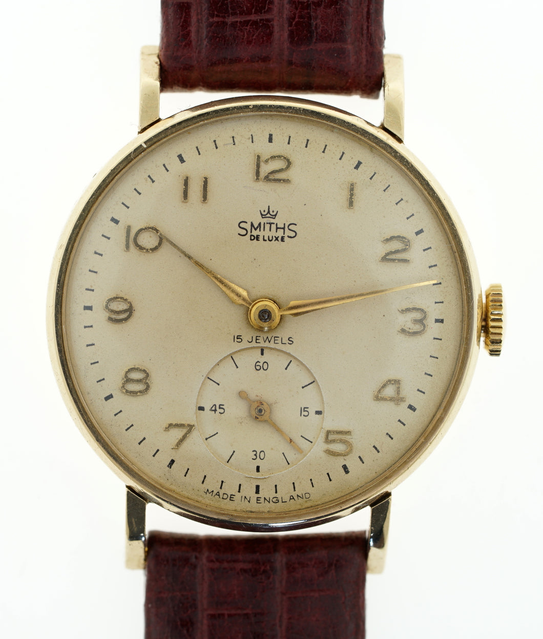 DELUXE SMITHS MODEL A 501 1955/6 9 CT GOLD ENGLISH WRISTWATCH WITH STEPPED LUGS DENNISON CASE