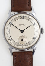 SMITHS EARLY HORN LUG STAINLESS STEEL AND CHROME WRISTWATCH SERVICED.
