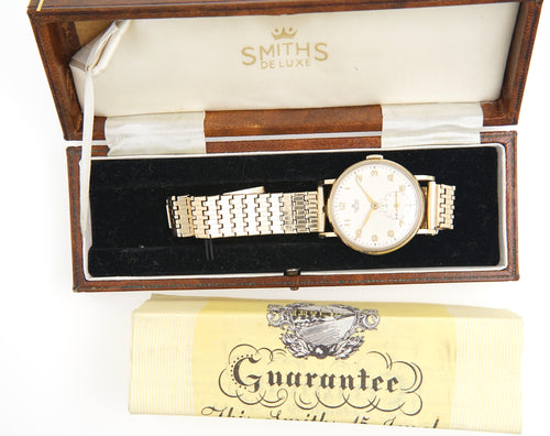 DELUXE SMITHS MODEL A501 1955 AUSTIN MOTOR COMPANY 9 CT GOLD ENGLISH WRISTWATCH GOLD BRACELET WITH BOX PAPER