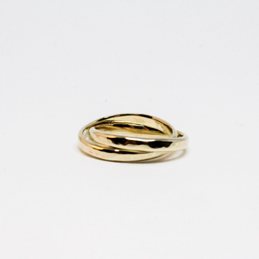 Interlocked Gold Rolling Rings