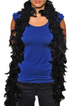 Women in blue shirt wearing black feather boa