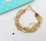 Golden shower bracelet