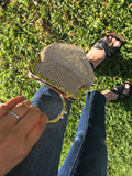 Golden mesh clutch