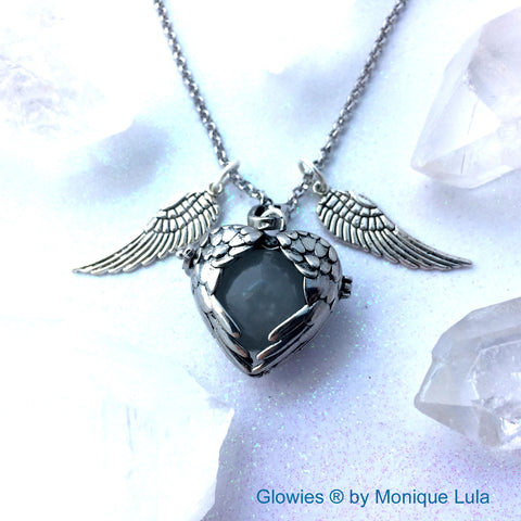Angel Wings Flying Orb Glow Locket ®