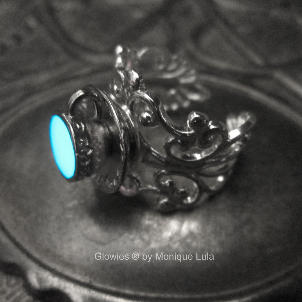 Glowing Tea Cup Alice in Wonderland Ring