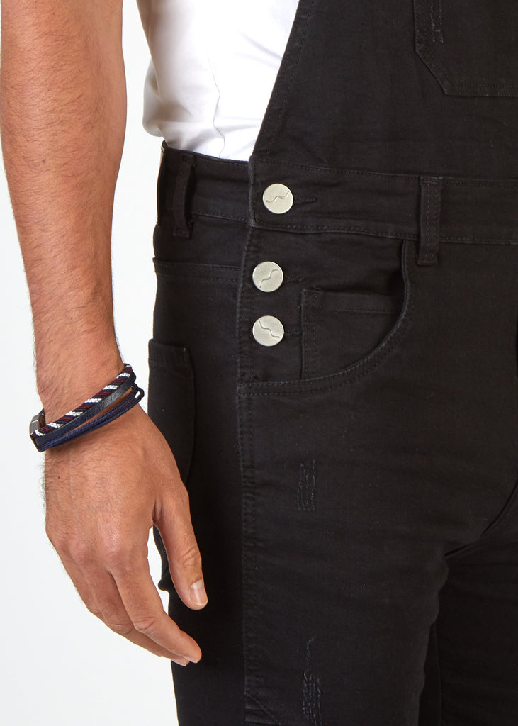 Close up shot of Trafford black slim fit dungaree shorts, side button fastening