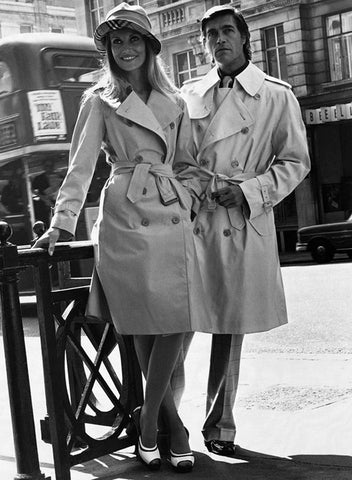 A 1973 Burberry ad featuring models in the iconic trench coat
