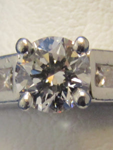 PLATINUM ROUND DIAMOND SOLITAIRE RING .55CTS. D COLOR, VS2 CLARITY...PRINCESS CUT ACCENTS!!